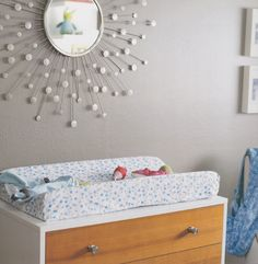 Try a visually stimulating accessory, like this #mirror, to hold baby's attention on the #ChangingTable. #gray #nursery