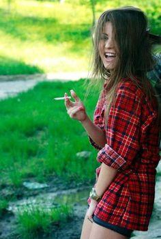 Big boobs brunette smoking a cigarette