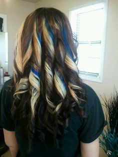 Subtle blue streaks in blonde brown hair. Love the curls and contrast and subtlety.