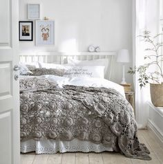 White bedroom with a beautiful taupe crocheted spread