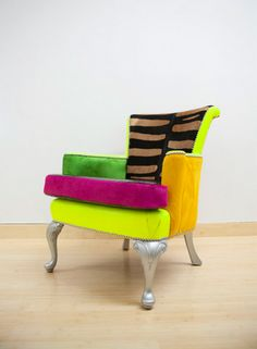Cover a chair with different color fabric. Or recover the cushion for a pop. Of color