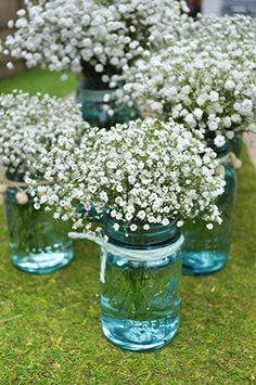 For centerpieces and maybe also hanging from every other church pew with twine or ribbon. Baby's breath = uber-cheap!