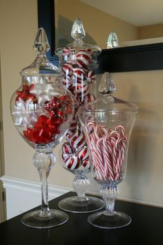 Great way to display different Christmas décor items, like bows, mini ornaments, and candy canes, as shown. These glass containers are so versatile, they could also be great to use for other holidays as well!