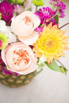 Flowers in a pineapple: http://www.stylemepretty.com/living/2015/07/29/flamingo-inspired-birthday-party/ | Photography: Amy & Jordan - http://amyandjordan.com/