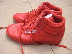 Reebok high tops. Tied and velcro'd.  I had a black pair!