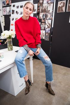 Casual Chic: Red Crewneck Sweater, Leopard Blouse, Vintage Rip Jeans, Leopard Boots and Gold Jewelry Accents