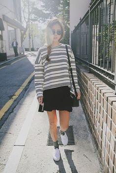 Black skater skirt with oversized striped jumper.