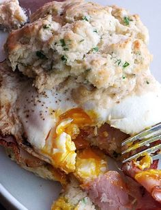 Chive Biscuit Sandwich with Cheddar Spread, Canadian Bacon, and a Fried Egg.  (http://www.yummly.com/recipe/external/Chive-Biscuit-Sandwich-with-Cheddar-Spread_-Canadian-Bacon_-and-a-Fried-Egg-Serious-Eats-203398)
