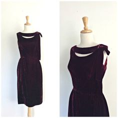 Vintage 50s wiggle dress. Cocktail dress with peek-a-boo bodice and bow embellished shoulder (left). Elegant burgundy velvet. Metal back zipper closure. Dress is lined from the waist up. Additional fabric, condition and measurement information provided for your consideration. Maker: