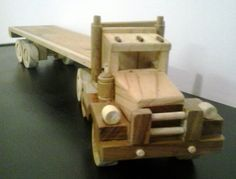 Hand crafted wooden toy horse and flat bed trailer.self made