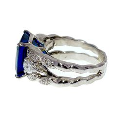 Bright Blue Tanzanite Diamond Platinum Ring | From a unique collection of vintage more rings at https://www.1stdibs.com/jewelry/rings/more-rings/