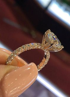 14 Karat Rose Gold Diamond Under Halo Wedding Ring With Oval