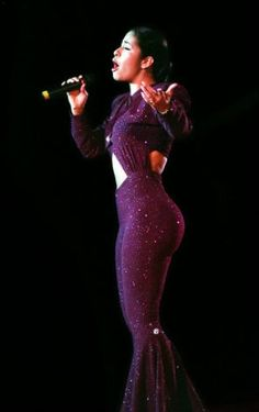 Tejano music star Selena performs at the Spurs Stay in School Jamboree in the Alamodome in San Antonio in this March 18, 1995
