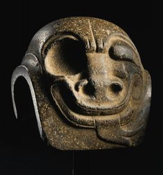 Middle Formative, Olmec style Mexico Carved yuguito, 1000–500 B.C. Dark gray granite h. 13 cm., w. 13 cm. Museum purchase, gift of the Wallace S. Whittaker Foundation, in memory of Wallace S. Whittaker, Yale Class of 1914