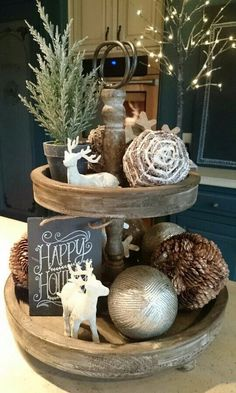 Happy holidays! What a cute farm house inspired Christmas centerpiece.  It's all about the details, and those little reindeer are pulling at our heart strings.  . #holidays #christmas #centerpiece #farmhouse #details #reindeer #festive