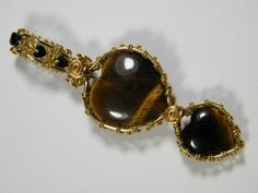 Woven wire wrapped natural Tiger Eye hearts by NoStoneLeftUnturned