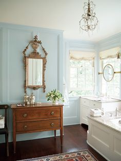 Here, Benjamin Moore's A Breath of Fresh Air appears on the walls of a bathroom.
