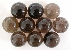 smoky quartz - Smoky Quartz is almost a default crystal in any crystal layout. It is grounding, protective and can transform negative energy into positive energy. As one friend put it to me, Smoky Quartz is good for humans, because we are currently quite murky beings ourselves!