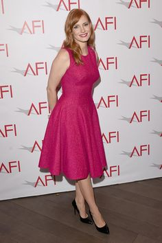 Jessica Chastain at the AFI Awards in a bright pink Lela Rose fit and flare dress and black patent pumps, January 2015. Celebrity dresses   celebrity fashion