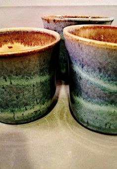 Making cups and mugs is an absolute joy to me. I love to make things that fit comfortably in your hand. That you just want to hold and sip your favorite warm beverage out of while looking at the snow or rain. The shape of these cups is perfect for the above scenario and the glaze combination is one of my favorites. A beautiful seductive blue complimented by the warm Asian aesthetics of the Shino. However, sometimes it doesnt always go perfectly in the kiln. These three cups had slight…