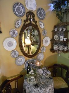 Black Transferware around a hand carved mahogany French mirror
