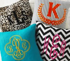 these unique monogrammed pillows are fantastic...would add a punch of life almost anywhere in the home!