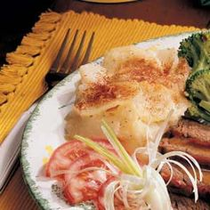 """Scalloped Potatoes and Onions Recipe -Writes Dorothy Bateman from Carver, Massachusetts. """"This creamy potato dish is so delicious. You can prepare it in the morning, than put it in the oven later—just be sure the sauce covers the potatoes so they won't turn brown."""""""