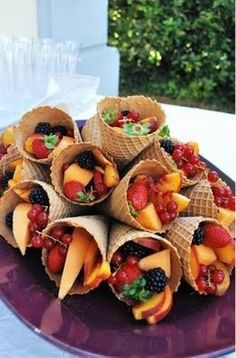 Mixed Fruit in a Cone. Great for a crowd, fill and stack, keep cool. When it comes to serving, everyone can help themselves to a healthy snack. I thought also of DIY toppings bar for yogurt,whipped cream, sundae drizzles,  sliced almonds to ramp it up!!! YUM!