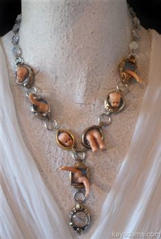 Salvador Dali's Dollies Necklace. Crazy Funky Wild & Weird.  Comically Noir Drowning Doll Parts Necklace. Kay Adams