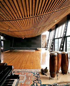Adjacent to the owner's larger home, the Music Studio, with its bowed, ship-like ceiling, was designed to house events, parties, and performances.