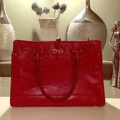 Salvatore ferragamo red bag This is gorgeous.  It's the Brianna and again another find at poshmark. I have worn this bag 2 times and gotten compliments on it both times. Perfect condition. Inside the lining has a small tear. Not noticeable. Will post another listing with more pictures. Also the strap that closes the bag has a wrinkle and is seperating. It's not noticeable when the bag is closed. I have a pic in the other listing. Salvatore Ferragamo Bags