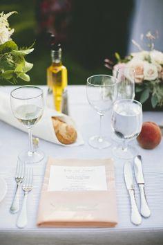 blue and white pinstripe linens with peach place setting #tablescape #weddingreception #weddingchicks http://www.weddingchicks.com/2014/03/21/pretty-peach-wedding/