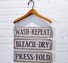Our wood hanger with distressed metal laundry sign looks great while it spells out the task ahead. For more laundry signs visit Antique Farmhouse. Decor, Wood Hangers, Signs, Vintage Hangers, Cozy House, Laundry Signs, Laundry In Bathroom, Home Decor, Laundry Room Signs
