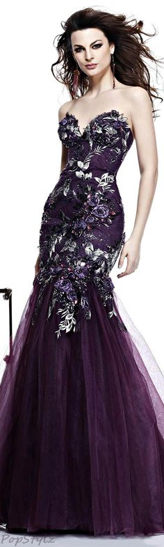 It's purple. It has flower detailing. Gorgeous.