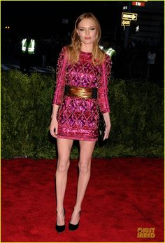 Kate Bosworth dons an eye-catching hot pink dress at the 2013 Met Gala held at the Metropolitan Museum of Art on Monday (May 6) in New York City.    The 30-year-old…