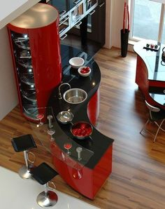 Contemporary kitchen design. Red and black colors. Modern kitchen ideas. For more decor inspirations http://www.bocadolobo.com/en/inspiration-and-ideas/