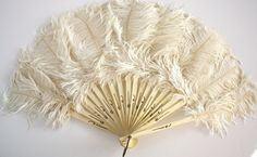 >y<  antique feather and ivory fan