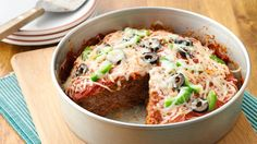 It's a new wedge of meatloaf!  A cake pan bakes a round pizza shape complete with pizza toppings.