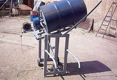 Cement Mixer by george pap -- Homemade cement mixer constructed from pipe, tubing, wheels, a steel drum, electric motor, gearbox, and pulleys. http://www.homemadetools.net/homemade-cement-mixer-5