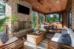This organic modern mountain home was designed by Living Stone Design + Build, in collaboration with ID.ology Interiors & Design, located in Asheville, North Carolina. The exterior and interior… Modern Mountain Home, Mountain Homes, Modern Outdoor Kitchen, Outdoor Spaces, Outdoor Living, Porch Kits, Porch Ideas, Rustic Patio, Building A Porch