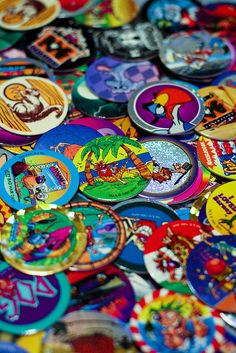 I don't even remember why pogs were so much fun when we were little but I used to have hundreds of these. 90's kids were so much more simple than kids now-a-days.
