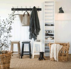 just a row of hooks, matching stools and basket transform a small space into a 'mudroom'.  The pretty details transform the shelf from Ikea-dorm-room to classic function.