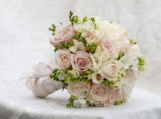 Bridal bouquet with blush pink, white, and some greenery
