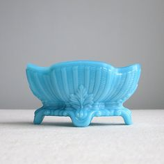 Hey, I found this really awesome Etsy listing at https://www.etsy.com/listing/264470267/vintage-turquoise-blue-milk-glass-dish