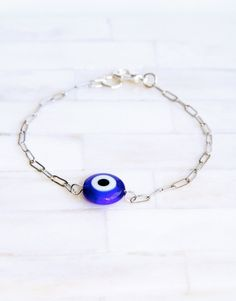 Evil Eye bracelet. I'd like the eye to be light blue like the necklace I have from this same seller :) $17.00