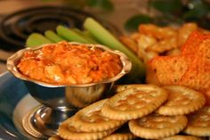 I first tried this buffalo chicken wing dip at my neighbors picnic.  A friend of theirs brought it and we munched on it all night til it was gone!  I love this recipe for picnics, potlucks and tailgate parties.  Its a much less messy way of enjoying chicken wings.  My oldest son loves it.  You can make it as spicy hot as you want...or leave it mild.  Its best served warm, but you can also eat it cool.