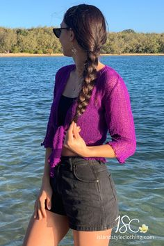 The Perfect Purple Cardigan to throw over a summer dress, bikinis, jeans, shorts, and more! You can roll this up in your bag and pop on after the sun goes down. Super cute additions to your wardrobe and so many colors to choose from. #casual #fashion #luau #cruisewear #summer #beachcoverup #bolero #cruisewear #beachcardigan #cardigan #over-swim #knit #knittedshrug #shrug #lightweight