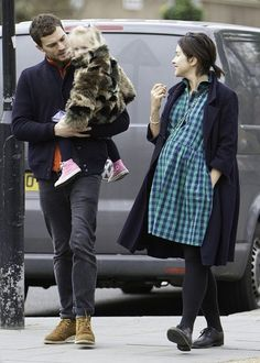 Part of this image has been pixellated to obscure the identity of the child Jamie Dornan and heavily pregnant wife Amelia Warner are pictured out on...