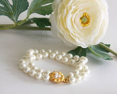 A personal favorite from my Etsy shop https://www.etsy.com/listing/150313706/pearls-bracelet-vintage-faux-peals-two