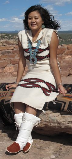 Laramie Blake wears a biil dress in her graduation picture from 2010. Biil is a traditional Navajo dress made from two woven panels that sewn together leaving openings for neck and arms. Now worn on special occasions a biil is often custom made.